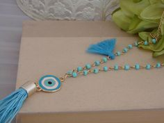 Greek Gold Tone Turquoise Blue  Evil Eye Tassel Necklace by ForThatSpecialDay on Etsy