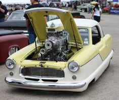 Cool pic of a Supercharger with a  Nash Metropolitan mounted to it.