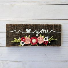This listing is for a wood sign that is stained dark brown and the words i {heart} you painted on in white. This sign measures approximately 9x3.5. Felt flowers are handmade from high quality wool and wool blend felts. If you want the colors customized, please let me know in the notes