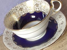 Antique Aynsley gold fleur de lis teacup and saucer