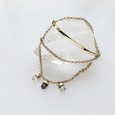 Crystal prisms hang from a brass chain that wraps twice around the wrist before ending at a solid brass bangle ✨ The Transformation Bangle is symbolic of the never-ending process of divine change, reminding you to go with it! Brass Chain, Solid Brass, Arrow Necklace, Wraps, Bangles, Change, Crystals, Jewelry, Bracelets
