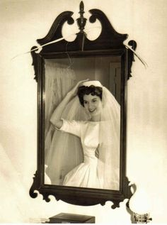 Admiring that bridal look in the mirror. | 60 Adorable Real Vintage Wedding Photos From The '60s Bring back the pillbox hat