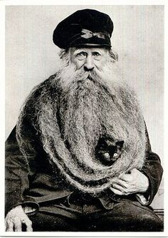 That beard should have it's own legend...look at the magnificence of it! Then of course there's the cat's expression. How the hell do I get out?? Unshackle me from this prison, human!