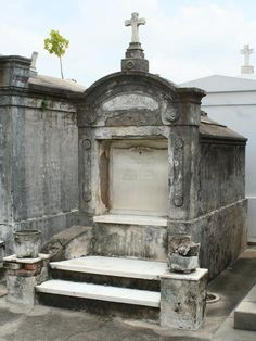 """One of the most unique features of New Orleans are our famous above-ground cemeteries. Building on swampy lands, below sea-level, New Orleanians have had to adapt over the years, and our stone crypts and mausoleums are a direct result of that adaptation to our environment. New Orleans' cemeteries host a plethora of interesting characters from the city's history, including the """"Voodoo Queen"""" Marie Laveau, as well as photographer, E.J. Bellocq."""