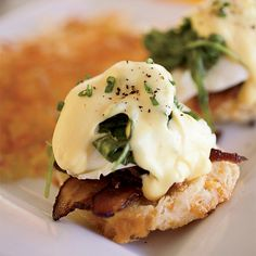 This variation on the classic eggs Benedict swaps traditional Canadian bacon for crisp applewood-smoked bacon.