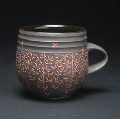 Fall is upon us! We love this mug by Debra Oliva that perfectly captures the season with cascading floral patterns.