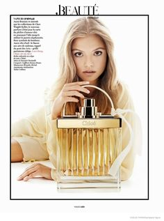 Magdelana Frackowiak Poses with Fragrance Bottles for Vogue Paris by Giampaolo Sgura