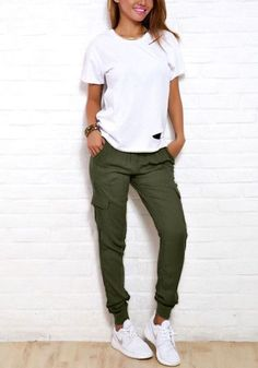 Lookbook Store // Look cool and stylish with this pair of rifle green cargo joggers. It's non-stretchable, has mid-rise waist with drawstrings and leg pockets for that true cargo style.
