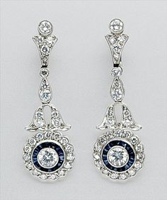 Pair of Diamond and Sapphire Pendant-Earrings   White gold, 56 diamonds ap. 2.20 cts., ap. 5 dwt.