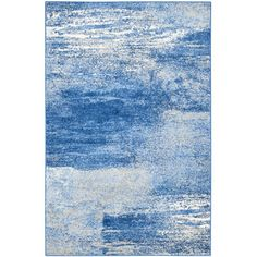 Make a stylish statement in your living room or master suite with this lovely rug, showcasing an abstract print in blue and silver.Pr...