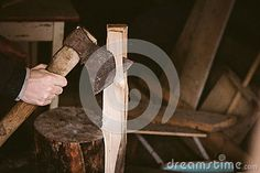 Everyday routine of a man in Russian village. Man chops firewood.