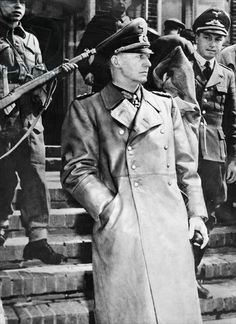 General Alfred Jodl escorted by British soldiers on his way to sign the unconditional surrender on behalf of the Wehrmacht in the headquarter of the western allies, Reims, 7th May 1945