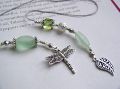 Dainty Dragonfly Boomark in Pale Green Matte Glass - Beaded Book Thong with Silver and Pearl Accents. $22.00, via Etsy.