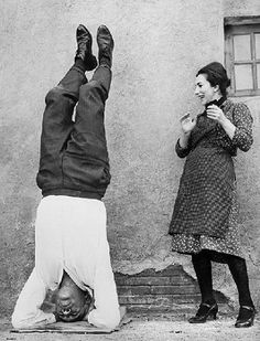 10. Actor Anthony Quinn delights Valentina Cortese with his awesome headstand, 1963. Credit: Relax and Release