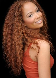 Long curly natural hair. This is what my hair will look like as it gets longer!! And my natural hair color is red too!!