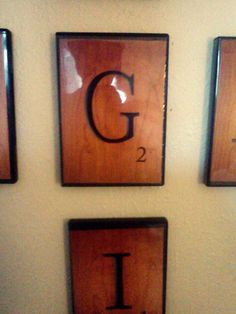 each letter tile is only a 5x7 print created in photoshop, slid in the side of a old dvd case and nailed to the wall.