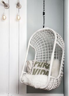 Hanging Chair Rattan White for the deck outside her room  love the sheepskin addition