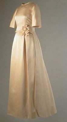 """Jackie Kennedy 1961  Oleg Cassini Ivory Double faced Silk Satin Twill  The Rosette at the waist a """"cockade""""  and ode to her affinty for 18th century fashion  And French Bouvier Ancestry"""