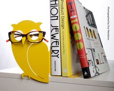 eyeglasses holder AND bookends in one?!!! brilliant! by Uligo on Etsy