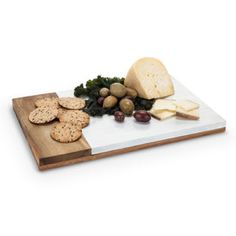 Serve aged cheeses, charcuterie, and hearty breads on the Viski Admiral Acacia Wood Cheese Board. This cheese board is made up of a solid acacia wood slab and stainless steel slat handles. Modern Grey Kitchen, Grey Kitchen Designs, Cheese Cutting Board, Cheese Boards, Cutting Boards, Marble Wood, White Marble, Artisan Cheese, Personalized Cutting Board