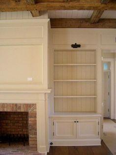 brick fireplace + space for tv + built-in bookshelves w/beadboard backing