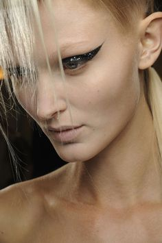 Extreme liner and sharp, elegant hair for  Haider Ackermann #SS14. Hair by Eugene Souleiman #pfw