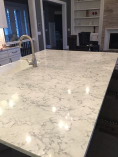 "Island with Apron Sink done in Viatera Quartz ""Rococo"" rather than Marble ... if you like ""no maintenance"" but want the look of Marble, you can't go wrong with this."