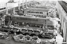 Five New Haven EP-4 passenger electric locomotives are in various stages of completion at General Electric's plant at Erie, Pa. In the background of this March 1938 photo,