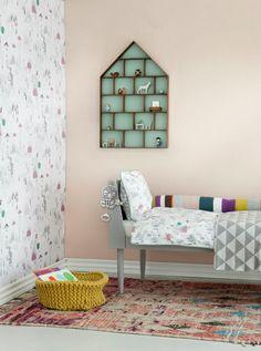 adorable shelf, fun wall paper, mismatched bedding + a knit basket!