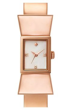 A pert bow influences the streamlined design of a rosegold-plated bangle watch topped with a pearly, crystal-sparked dial.