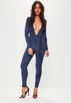 Nail the navy and elevate your style game wearing this beaut jumpsuit - featuring long sleeves, a faux suede fabric and plunging neckline.