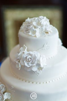 Classic white wedding cake with sugar flower details at CJ's Off the Square in Franklin, TN