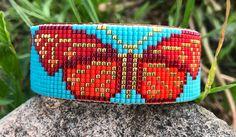 Bead Loom Bracelets, Beaded Bracelet Patterns, Seed Bead Patterns, Beading Patterns, Beading Ideas, Bead Loom Designs, Turquoise Background, Butterfly Bracelet, Beaded Cross