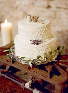 Simple vintage cake with little sprigs of lavender - love! Photo by Ryan Ray Photography. www.wedsociety.com #wedding #cake #vintage