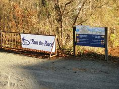 A banner for First Christian Church in Roanoke Rapids rests on the rail outside of the Roanoke Canal Museum.