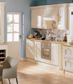 Small elegant kitchen with simple extractor fan and long cupboards.