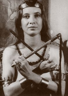"""Janet Farrar holds a flog and wand in """"Osiris position"""".  Image from """"A Witches' Bible"""""""