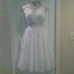 Beaded tier sun dress Plus size 3X This stunning white with silver beading sun dress is almost bridal.New with tags and in immaculate condition.  Hard to find plus size 3X.  Silver bead work at shoulder strap and smocked empire waist.  Dress is fully lined.  4 tier skirt.  Whether she accompanies you on vacation or to a wedding, You are going to make some fab memories in this classic dress! Classes Dresses Midi
