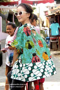 Batik Amarillis' Breezy Top .. it's Freesize , super cool,comfy ,sexy and…