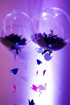 Giant balloons with Alice In Wonderland Tassels - and filled with grass! By Evolve Events
