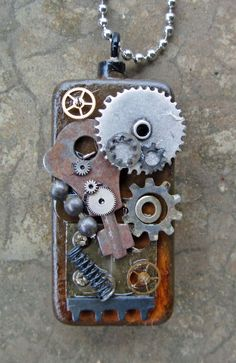 Steampunk Domino Necklace. $20.00, via Etsy. lovey mixed media creations by kathy mc elroy