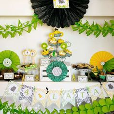 Dinosaur birthday party dessert table!  See more party planning ideas at CatchMyParty.com!