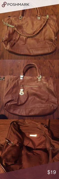 Steve Madden bag In EUC, beautiful gold hardware, inside in great condition as well. Great bag with lists of wear left! Steve Madden Bags