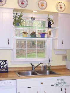 diy glass shelves in front of kitchen window, shelving ideas, See through glass window shelves allow light in and give you a spot to set your plants. This kitchen set up mimics my kitchen. Love the plates above too. Kitchen Window Shelves, Glass Kitchen Cabinet Doors, Kitchen Window Sill, Kitchen Window Treatments, Kitchen Windows, Wall Shelves, Sink Shelf, Kitchen Sinks, Kitchen Counters
