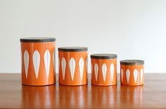 Catherineholm White Lotus on Orange Canisters. WANT!