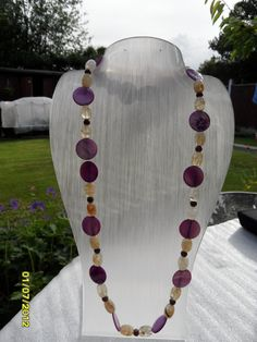Purple shell elastic necklace by therealmgemsdesign on Etsy,   £65.34