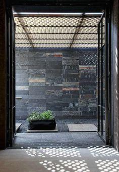 Faliro loft by Esé Studio. a rich combination of different textures, designs by Patricia Urquiola