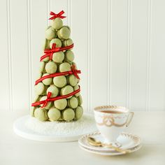 Christmas Macaron Tree. With directions on how to tea-infuse buttercream. Classic & chic, sure to be the centerpiece of any Christmas party!