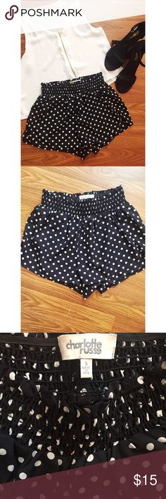 Polka dot stretch shorts. These polka dot shorts have a stretchy top. They have never been worn ! Fit more like an XS. Charlotte Russe Shorts