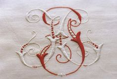 """Intertwined embroidered monograms - like how small touches of the """"other"""" color is in each letter"""